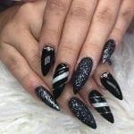 Black long stiletto acrylic nails with nail art