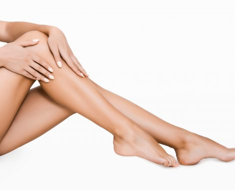 woman smooth long legs after waxing
